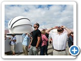 Dr. Deutsch, right, joins visitors in observing the first total solar eclipse to cross the US since 1918