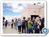 Visitors lined up to see the eclipse on the screens inside the UNM Campus observatory