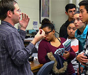 Research Assistant Professor Alexander Albrecht explains surface physics to visiting high school students